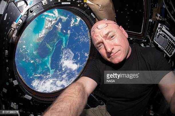 In this handout photo provided by NASA Expedition 44 flight engineer and NASA astronaut Scott Kelly is seen inside the Cupola a special module which...