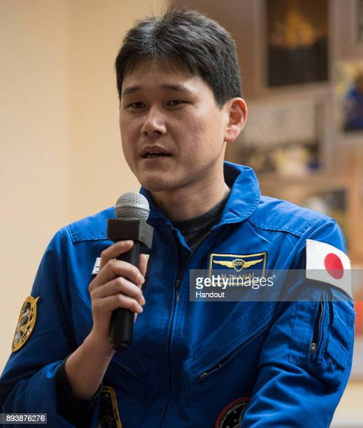 In this handout photo provided by NASA Expedition 54 flight engineer Norishige Kanai of Japan Aerospace Exploration Agency answers a question during...