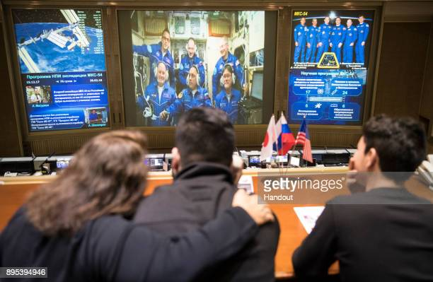 In this handout photo provided by NASA Expedition 54 flight engineers Scott Tingle of NASA bottom left Anton Shkaplerov of Roscosmos bottom center...