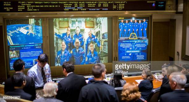 In this handout photo provided by NASA Expedition 54 flight engineers Scott Tingle of NASA bottom left Anton Shkaplerov of Roscosmos bottom center...