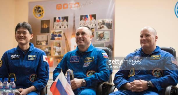 In this handout photo provided by NASA Expedition 54 prime crew members flight engineer Norishige Kanai of Japan Aerospace Exploration Agency left...