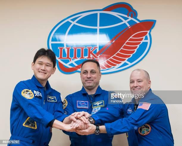 In this handout photo provided by NASA Expedition 54 prime crew members flight engineer Norishige Kanai of Japan Aerospace Exploration Agency right...