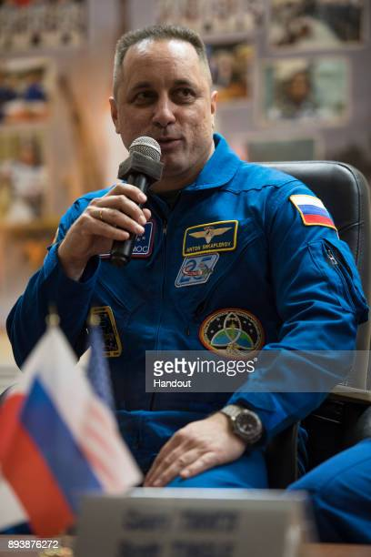 In this handout photo provided by NASA Expedition 54 Soyuz Commander Anton Shkaplerov of Roscosmos answers a question during a press conference...