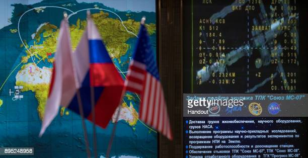 In this handout photo provided by NASA Icons for the International Space Station and Soyuz MS07 spacecraft are seen on a tracking map along with live...