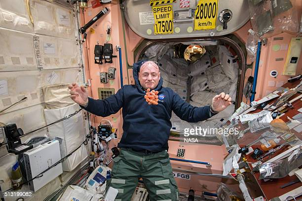 In this handout photo provided by NASA its snack time on the International Space Station as NASA astronaut Scott Kelly watches a bunch of fresh...