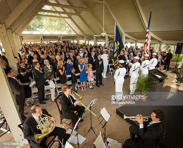 In this handout photo provided by NASA members of the US Navy Ceremonial Guard from Washington DC present the Colors during a memorial service...