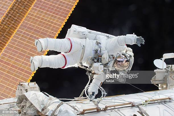 In this handout photo provided by NASA NASA astronaut Scott Kelly is seen floating during a spacewalk on December 21 2015 in space NASA astronauts...