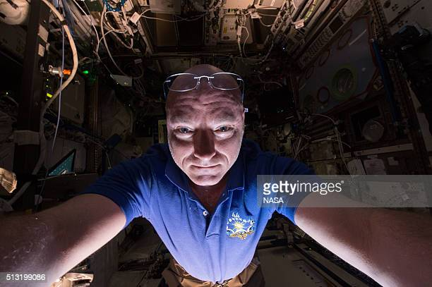 In this handout photo provided by NASA NASA astronaut Scott Kelly on the International Space Station prepares another scientific experiment on June...