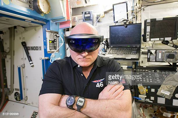 In this handout photo provided by NASA NASA astronaut Scott Kelly checks out the Microsoft HoloLens aboard the space station February 20 2016 in...