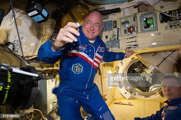 In this handout photo provided by NASA NASA astronaut Scott Kelly reacts to being aboard the International Space Station after the hatch opening of...