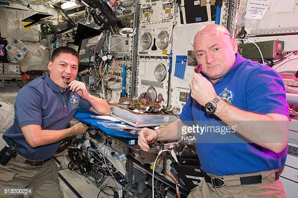 In this handout photo provided by NASA NASA astronauts Scott Kelly and Kjell Lindgren are getting their taste buds ready for the first taste of food...