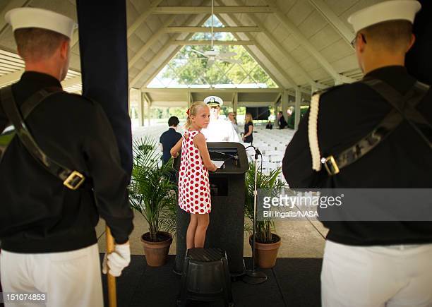 In this handout photo provided by NASA Piper Van Wagenen one of Neil Armstrong's 10 grandchildren is seen during preparation of a memorial service...