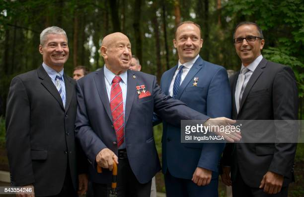 In this handout photo provided by NASA Russian Cosmonaut Alexei Leonov the first human to walk in space second from left meets with Expedition 53...