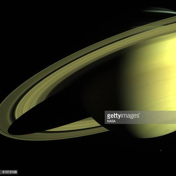 In this handout photo provided by NASA Saturn appears in an image returned by the CassiniHuygens spacecraft on May 16 when its imaging science...