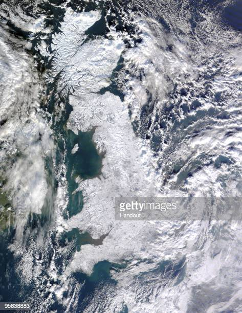 In this handout photo provided by NASA The British Isles covered in snow are seen from NASA's Terra satellite using a Moderate Resolution Imaging...