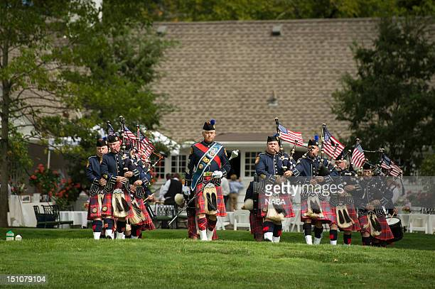 In this handout photo provided by NASA the Hamilton Co Sheriff's Office bagpipe corps concludes the memorial service celebrating the life of Neil...