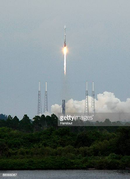 In this handout photo provided by NASA, the Lunar Reconnaissance Orbiter, onboard an Atlas V rocket, lifts off June 18, 2009 at Cape Canaveral,...