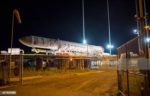 In this handout photo provided by NASA the Orbital Sciences Corporation Antares rocket with the Cygnus spacecraft onboard arrives at launch Pad0A at...