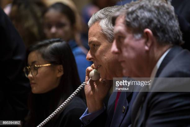 In this handout photo provided by NASA US Ambassador to Russia Jon Huntsman Jr speaks with the Soyuz MS07 crew from the Moscow Mission Control Center...