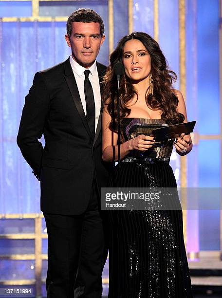 In this handout photo provided by NBC actor Antonio Banderas and actress Salma Hayek present an award onstage during the 69th Annual Golden Globe...