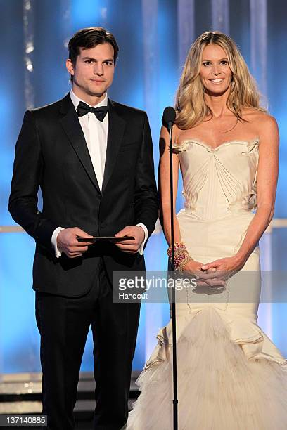 In this handout photo provided by NBC, actor Ashton Kutcher and TV personality Elle Macpherson presents an award onstage during the 69th Annual...