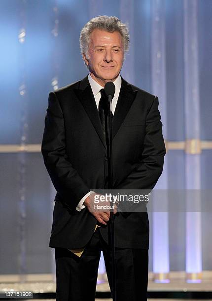 In this handout photo provided by NBC actor Dustin Hoffman presents an award onstage during the 69th Annual Golden Globe Awards at the Beverly Hilton...