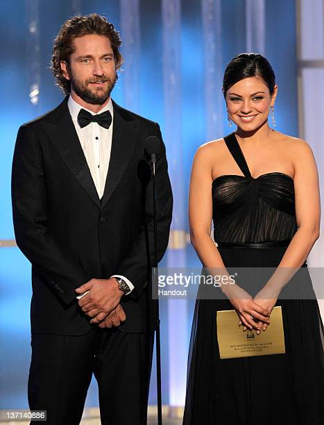 In this handout photo provided by NBC, actor Gerard Butler and actress Mila Kunis present an award onstage during the 69th Annual Golden Globe Awards...