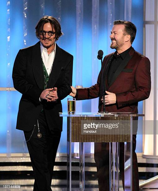 In this handout photo provided by NBC actor Johnny Depp and host Ricky Gervais talk onstage during the 69th Annual Golden Globe Awards at the Beverly...