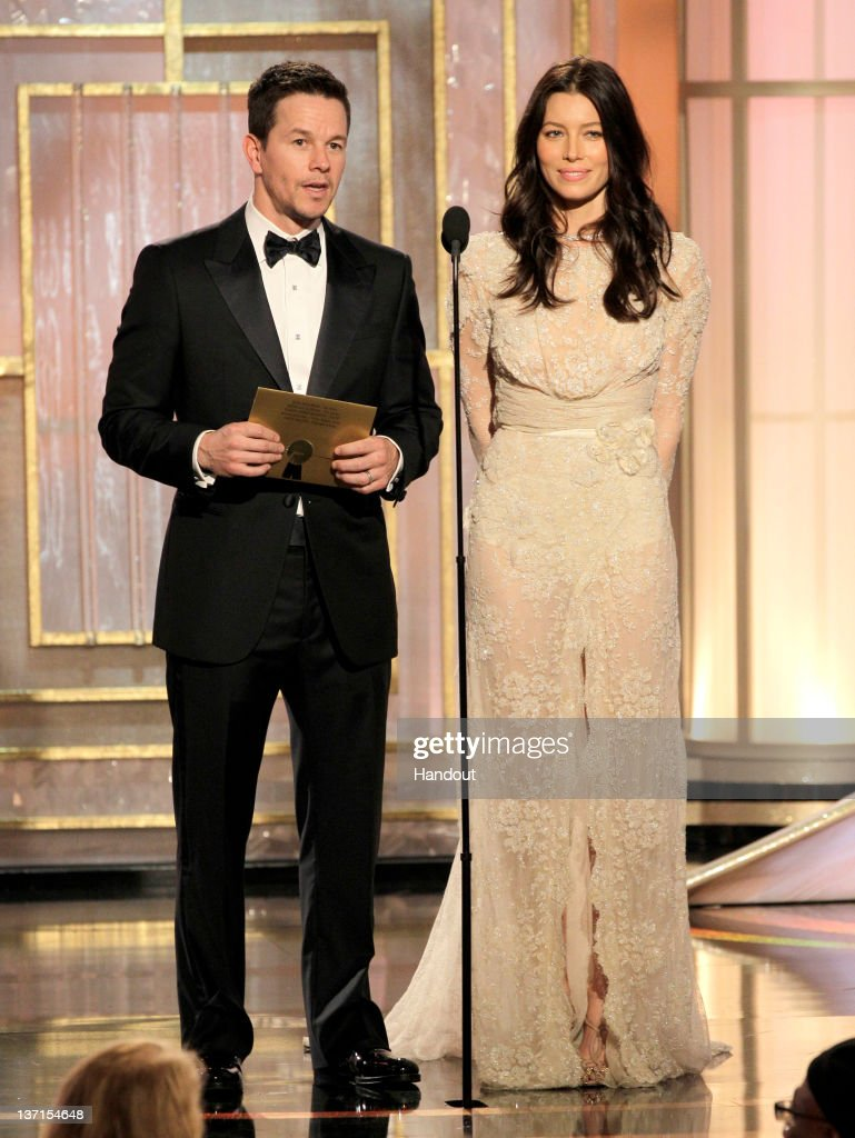 In this handout photo provided by NBC, actor Mark Wahlberg and actress Jessica Biel present an award onstage during the 69th Annual Golden Globe Awards at the Beverly Hilton International Ballroom on January 15, 2012 in Beverly Hills, California.