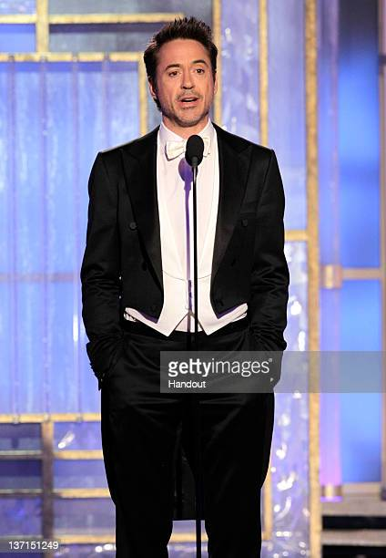 In this handout photo provided by NBC actor Robert Downey Jr presents an award onstage during the 69th Annual Golden Globe Awards at the Beverly...