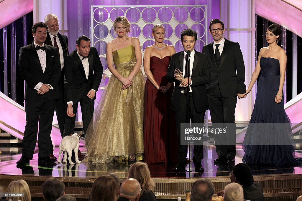 In this handout photo provided by NBC, (L-R) actors Ludovic Bource, James Cromwell, Jean Dujardin, Missi Pyle, Ann Miller, producer Thomas Langmann, director Michel Hazanavicius, and Berenice Bejo accept the Best Motion Picture - Musical or Comedy award for 'The Artist'onstage during the 69th Annual Golden Globe Awards at the Beverly Hilton International Ballroom on January 15, 2012 in Beverly Hills, California.