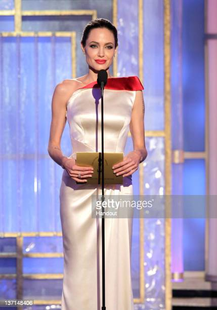 In this handout photo provided by NBC actress Angelina Jolie presents an award onstage during the 69th Annual Golden Globe Awards at the Beverly...