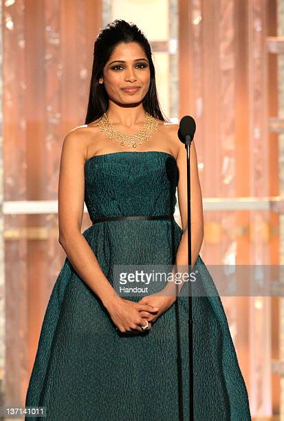 In this handout photo provided by NBC, actress Freida Pinto presents an award onstage during the 69th Annual Golden Globe Awards at the Beverly...