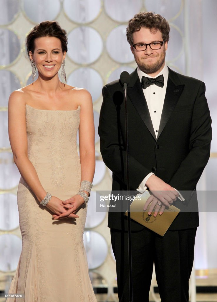 In this handout photo provided by NBC, actress Kate Beckinsale and actor Seth Rogen present an award onstage during the 69th Annual Golden Globe Awards at the Beverly Hilton International Ballroom on January 15, 2012 in Beverly Hills, California.