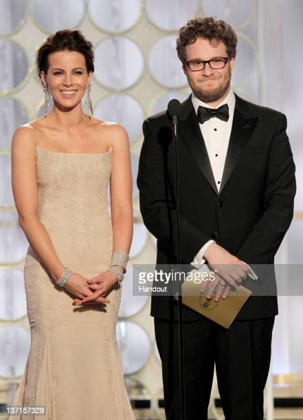In this handout photo provided by NBC actress Kate Beckinsale and actor Seth Rogen present an award onstage during the 69th Annual Golden Globe...
