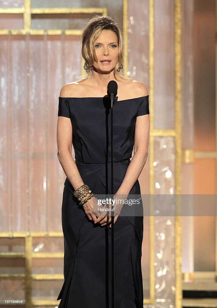 In this handout photo provided by NBC, actress Michelle Pfeiffer presents an award onstage during the 69th Annual Golden Globe Awards at the Beverly Hilton International Ballroom on January 15, 2012 in Beverly Hills, California.