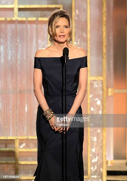 In this handout photo provided by NBC actress Michelle Pfeiffer presents an award onstage during the 69th Annual Golden Globe Awards at the Beverly...