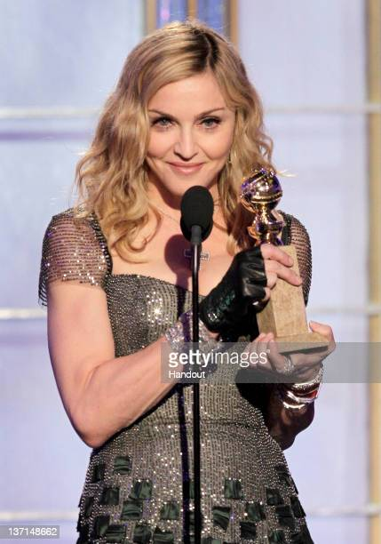 "In this handout photo provided by NBC, Madonna accepts award for Best Original Song - Motion Picture "" Masterpiece"" from W.E. Onstage during the 69th..."