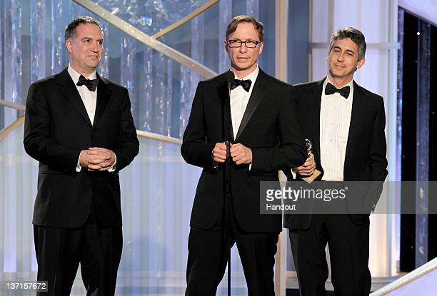 In this handout photo provided by NBC producers Jim Taylor Jim Burke and writer/director Alexander Payne accept the award for Best Motion Picture...