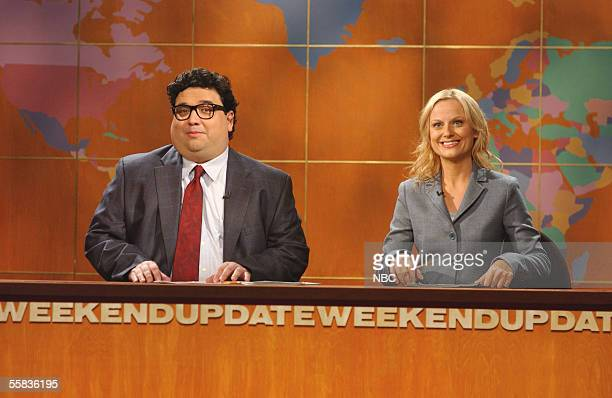 In this handout photo provided by NBC studios Amy Poehler and Horatio Sanz perform during Weekend Update on Saturday Night Live's season premiere at...