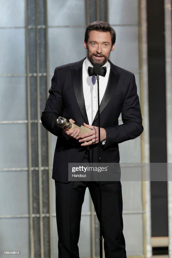 In this handout photo provided by NBCUniversal, Actor Hugh Jackman accepts the Best Actor award for Motion Picture, Comedy or Musical on stage during the 70th Annual Golden Globe Awards at the Beverly Hilton Hotel International Ballroom on January 13, 2013 in Beverly Hills, California.