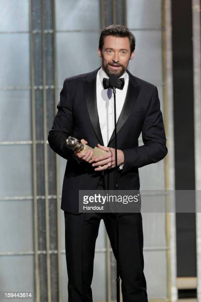 In this handout photo provided by NBCUniversal Actor Hugh Jackman accepts the Best Actor award for Motion Picture Comedy or Musical on stage during...