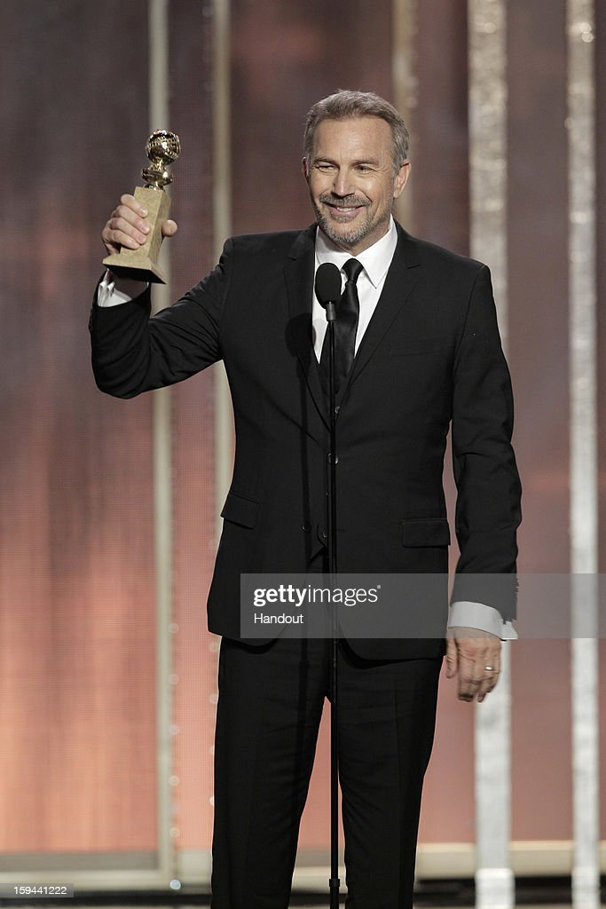 In this handout photo provided by NBCUniversal, Actor Kevin Costner accepts the Best Actor award for Mini-Series or TV Movie, 'Hatfields & McCoys' on stage during the 70th Annual Golden Globe Awards at the Beverly Hilton Hotel International Ballroom on January 13, 2013 in Beverly Hills, California.