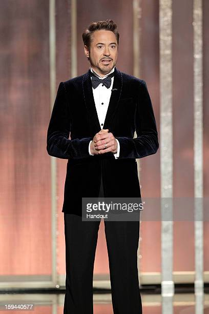 In this handout photo provided by NBCUniversal Actor Robert Downey Jr on stage to present during the 70th Annual Golden Globe Awards at the Beverly...