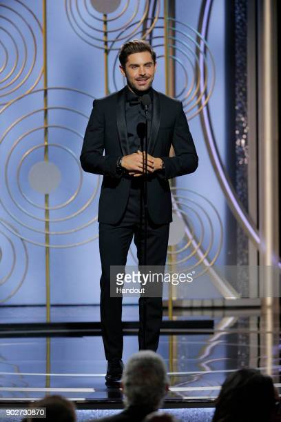 In this handout photo provided by NBCUniversal Actor Zac Efron speaks onstage during the 75th Annual Golden Globe Awards at The Beverly Hilton Hotel...