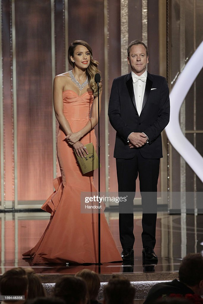 In this handout photo provided by NBCUniversal, Actors Jessica Alba and Keifer Sutherland on stage to present during the 70th Annual Golden Globe Awards at the Beverly Hilton Hotel International Ballroom on January 13, 2013 in Beverly Hills, California.