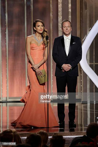 In this handout photo provided by NBCUniversal Actors Jessica Alba and Keifer Sutherland on stage to present during the 70th Annual Golden Globe...