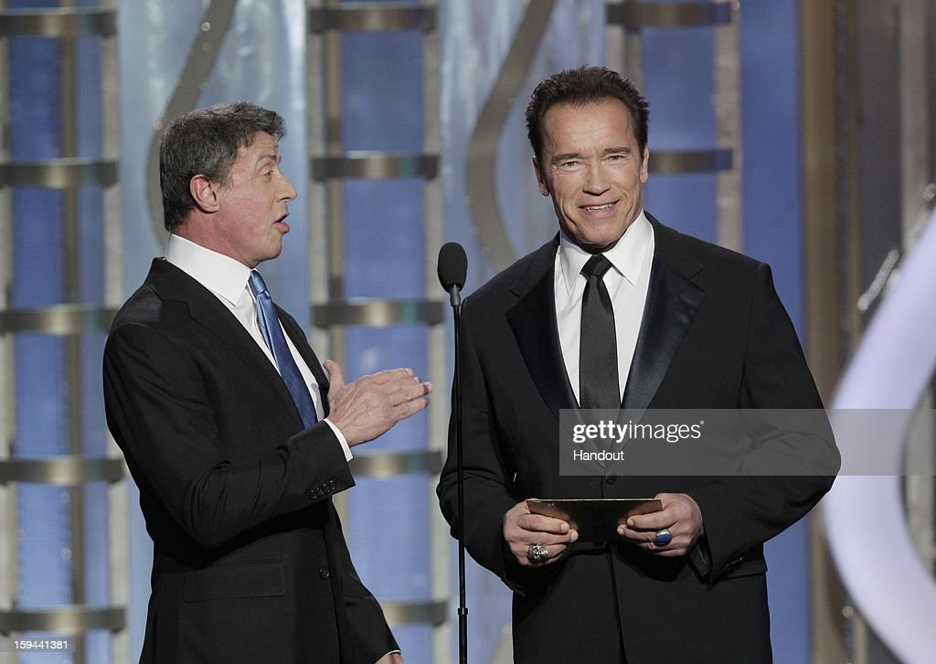 In this handout photo provided by NBCUniversal, Actors Sylvester Stallone and Arnold Schwarzenegger on stage to present during the 70th Annual Golden Globe Awards at the Beverly Hilton Hotel International Ballroom on January 13, 2013 in Beverly Hills, California.