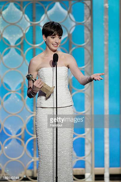 """In this handout photo provided by NBCUniversal, Actress Anne Hathaway accepts the Best Supporting Actress award for Motion Picture, """"Les Miserables""""..."""