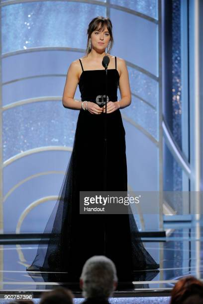 In this handout photo provided by NBCUniversal Actress Dakota Johnson speaks onstage during the 75th Annual Golden Globe Awards at The Beverly Hilton...